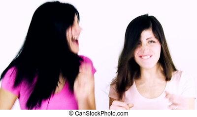 Two beautiful girls expressing joy
