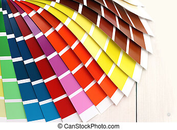 Pantone color palette on white wooden background, close up