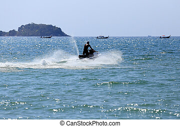 man drive on the jetski at Patong beach, Phuket, Thailand