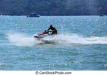 man drive on the jetski at Patong beach, Phuket, Thailand