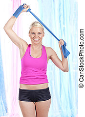 Sporty woman with thera band doing exercises