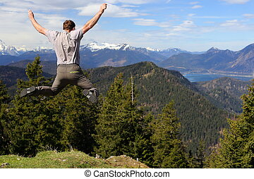 funny jumping man in nature with lake in background