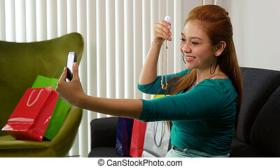 Latina Girl With Shopping Bags Taking Selfie With Phone -...