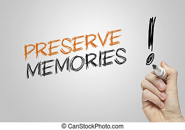 Hand writing preserve memories on grey background
