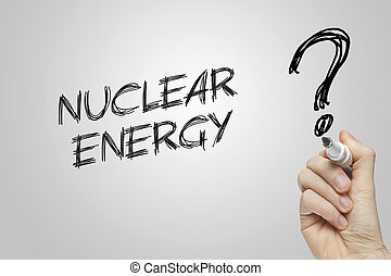 Hand writing nuclear energy on grey background