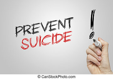 Hand writing prevent suicide on grey background