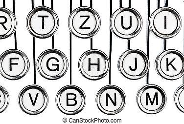 keys on a typewriter - an old typewriter keyboard. symbolic...