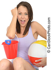 Portrait of a Happy Excited Young Woman Holding a Bucket and Spade and Beach Ball Smiling