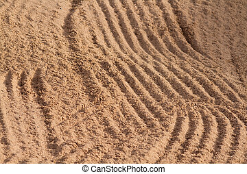 Sand Trap rake pattern in the sand