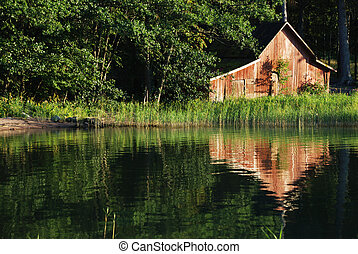 old boat-house - the old wooden boat-house on the seashore...