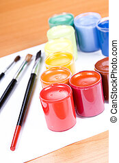 paint - colorful paint with paintbrush on table
