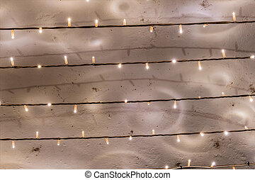 fairy lights bulbs in series, a symbol of power consumption,...