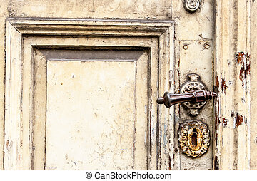 old door with squiggly jack, symbol of decay, past, old...