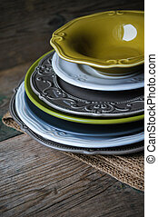 Table setting on the old wooden table - Vitage plates on the...