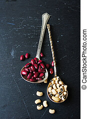 Raw beans - Different types of beans in the vintage spoons...