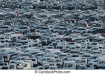 Carpark - Rows of brand new cars and trucks parked and...