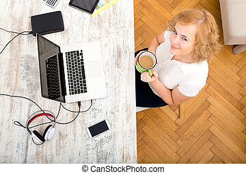 Woman in the home office - A plus size adult woman working...