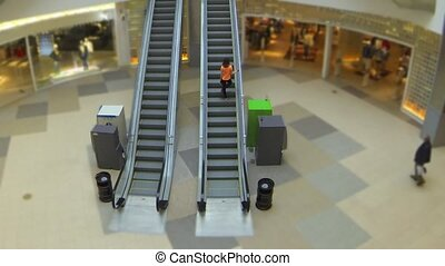 escalator time lapse - mall center escalator motion top view...