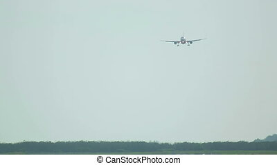 Final approach - Jet airplane approaching, telephoto lens,...