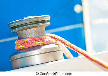 Winch capstan with rope on sailing boat. Yachting yacht in...