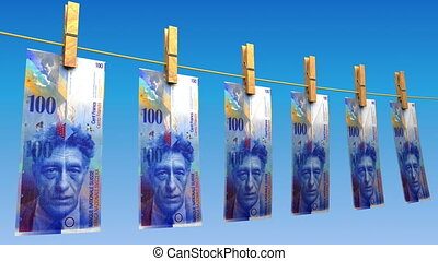 Drying Swiss Francs Loop - 100 CHF bills hanging on blue...