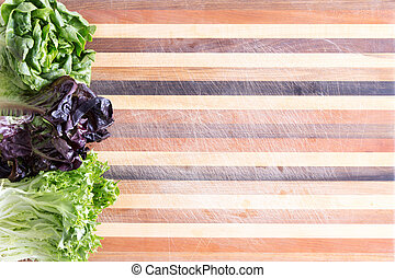 Fresh lettuce border on a decorative board - Fresh lettuce...