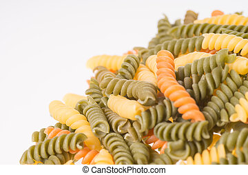 Pasta Spirelli over a white background
