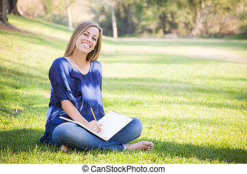 Portrait of a Beautiful Young Woman With Book Outdoors