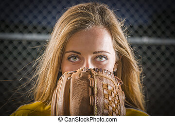 Young Woman with Softball Glove Covering Her Face Outdoors -...