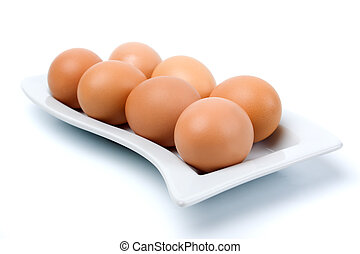 Brown chicken eggs isolated on white