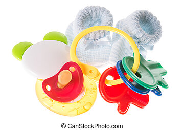 Baby Stuff - baby toy with teether and baby shoes isolated...
