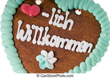Welcome - Gingerbread heart with the words warm welcome