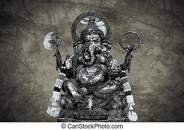 idol of Hindu god Ganesha on cracked stone wall background