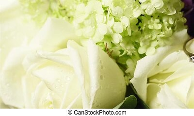 flowers with wedding rings