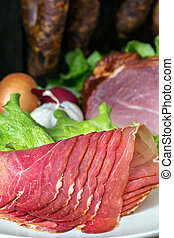 smoked ham with schwarzwald ham and prosciutto - collage of...