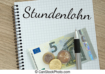 Minimum Wage - Writing pad with money and the german words...