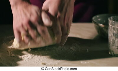 Hands kneading a dough - female hands kneading a dough