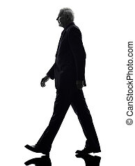 senior business man walking silhouette