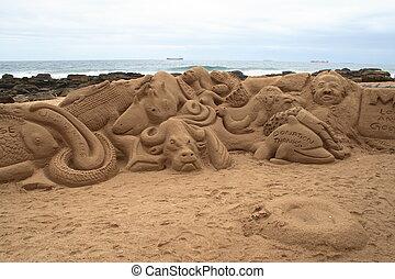 beach sand art - art sculpted on the beach in sand