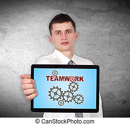 teamwork symbol - businessman holding touch pad with...