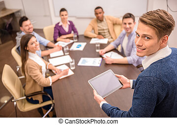 Co-working - Teamwork concept. Mixed group business partners...