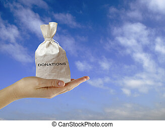 Hand with bag of donations