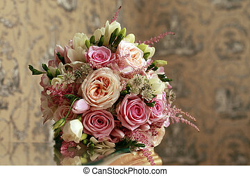 Wedding bouquet from roses on a abstract background