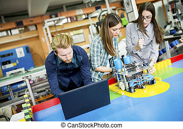 Young people in the classroom - Young people in the robotics...