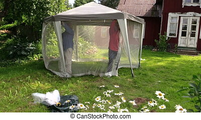 men gazebo insect screen - two men fix transparent insects...