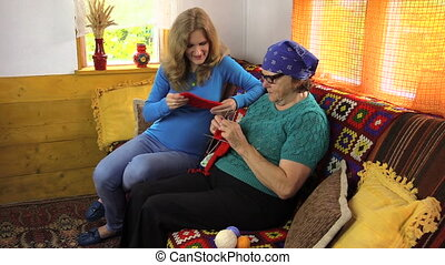 woman knit talk sit sofa - pregnant women looking grandma...