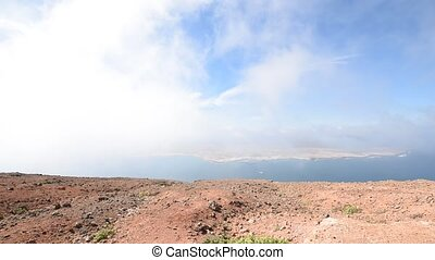 Timelapse with clouds and the coast of Lanzarote, Canary...