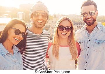 The best friends ever. Four young cheerful people bonding to...