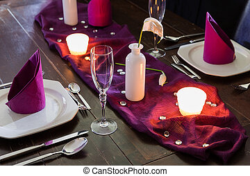 romantic dinner - table with place setting for two persons...