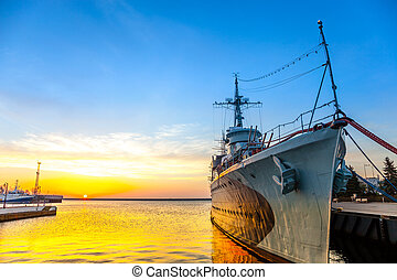 Warship at sunrise in the port of Gdynia, Poland